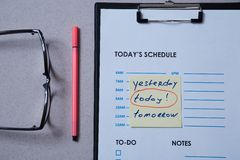 Time management deadline and schedule concept: schedule sheet and sticker with inscription on grey background.  stock photos