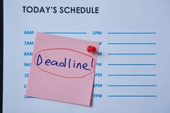 Time management deadline and schedule concept: schedule sheet and sticker with inscription on grey background.  royalty free stock images