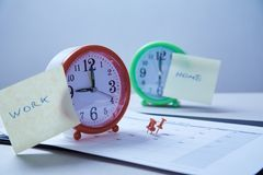 Time management deadline and schedule concept: stickers pasted on the table clock and red pushpin.  stock photography