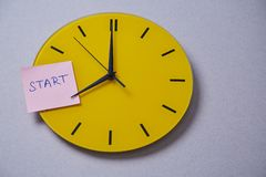 Time management deadline and schedule concept: yellow clock covered with stickers.  royalty free stock photos