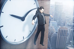 Time management hanging on arrow Royalty Free Stock Photography