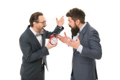 Time management. mature bearded men in formal suit hold alarm clock. deadline. late again. angry businessmen. bad. Morning. a lot of work. Time is money royalty free stock image