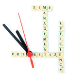 Time management puzzle. Word solution with time management, prioritize and efficiency as keywords, with clock hands Stock Images