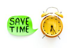 Time-management. Save time hand letterng in cloud near alarm clock on white background top view space for text. Time-management. Save time hand letterng in cloud royalty free stock photo