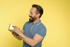 Time management skills. Man planning schedule hold notepad. Man bearded manager happy smiling face. Successful man stock photo