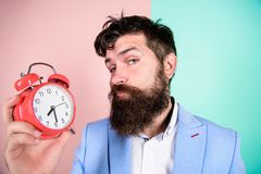 Time management skills. Time to work. Man bearded sleepy tired businessman hold clock. Stress concept. Hipster stressful. Working schedule. Businessman has lack stock photos