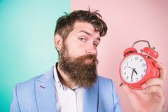 Time management skills. Time to work. Man bearded sleepy tired businessman hold clock. Stress concept. Hipster stressful. Working schedule. Businessman has lack stock images