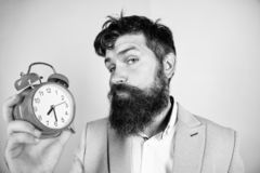 Time management skills. Time to work. Man bearded sleepy tired businessman hold clock. Stress concept. Hipster stressful. Working schedule. Businessman has lack stock photo