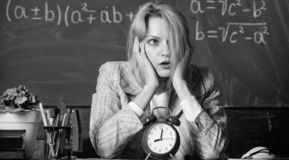 Time management. teacher with alarm clock at blackboard. Time. Study and education. Modern school. Knowledge day. School. Home schooling. Tired woman. Back to stock images