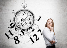 Time management thoughtful businesswoman Stock Images