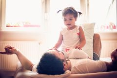 Time for me and my little girl. Happy young father. stock photo