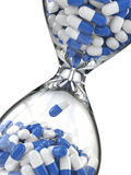 Time of medicine. Pills in hourglass Royalty Free Stock Photos