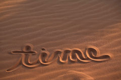 Time message drawn in sand Stock Image