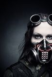 Time of misery. Portrait of post apocalyptic girl in gas mask over dark background royalty free stock photo