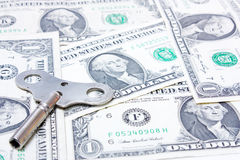 Time and money. Time key with some dollars Stock Image