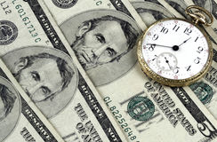 Time And Money. Pocket Watch And Five Dollar Bills portray the concept of time and money Royalty Free Stock Image