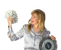 Time and Money. Businesswoman holding Money and clock. on white background Stock Photo