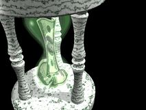Time is money. American 100 dollar bills stuffed in marble hourglass against black Stock Photos