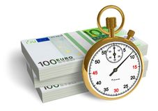 Time is money. Golden stopwatch with stacks of euro Royalty Free Stock Image