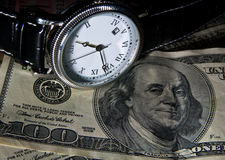 Time is money. Watches and 100 dollar bills Royalty Free Stock Images