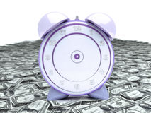 Time is money. Alarm clock over heap of money isolated Stock Photos