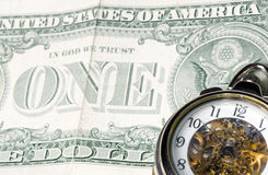 Time is money. Management of time concept with a classic watch an united states dollar Royalty Free Stock Image