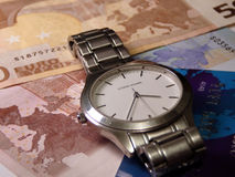 Time and money. Clock, money and credit card Stock Image