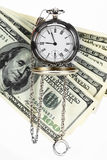 Time is money. Old pocket watch and the dollar Royalty Free Stock Images