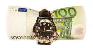 Time is money. 100 euro bill inside a wristwatch suggesting the old say: time is money Stock Photo