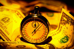 Time is Money. Stopwatch and Money Royalty Free Stock Photography