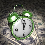 Time is money. Green alarm and 100-dollar notes Stock Photo