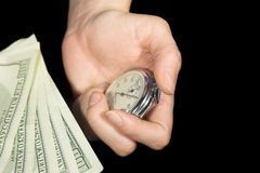 Time is money 2. The stop-watchin hand near the dollar cash isolated on black Stock Images