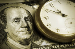 Time and Money. Photo of a dollar and a watch Royalty Free Stock Images