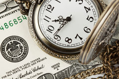 Time and money. Concept image. Pocket watch and US currency Stock Photos