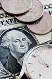 Time is money. Financial time concept with money and watch Royalty Free Stock Image