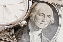 Time is money. Financial time concept with money and watch Stock Images