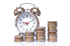 Time is money. Euro coins and alarm clock on white background Royalty Free Stock Image