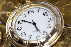 Time is money. Golden watch around U.S. coins (time is money concept Stock Photography