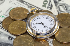 Time is money. Golden watch around U.S. coins (time is money concept Royalty Free Stock Photo
