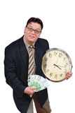 Time is money. Young business man with clock and euro banknotes, isolated over white. Business concept of time equals money Royalty Free Stock Image