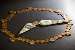 Time is money. Clock made from US coins and dollars (time is money concept Stock Photos