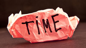 Time is money. Ball of crumpled paper with conceptual text - word time Stock Images