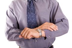 Time is money. Businessman checking on the time royalty free stock photos