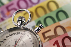 Time is money. Stopwatch and the European currency Royalty Free Stock Photo