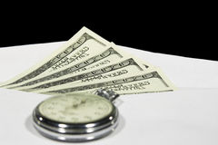 Time is money 3. The stop-watch on the dollar cash in the envelope Stock Photos