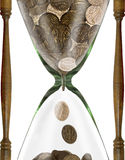 Time is money. Hourglass with coins stock photos