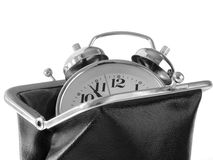 Time is money. Classic alarm clock in old style purse time is money concept Stock Image