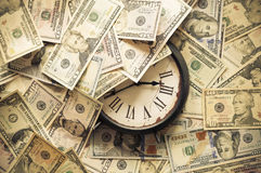Time is money. Abstract background of U.S. dollar and a clock Royalty Free Stock Images