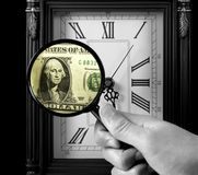 Time is Money. An old clock, a magnifying glass and a one-dollar bill Stock Image