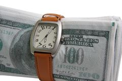 Time is money. Watches wristled over fake money isolated Royalty Free Stock Photography